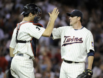 MINNEAPOLIS, MN - AUGUST 10: Joe Mauer #7 and Joe Nathan #36 of the Minnesota Twins celebrate a win against the Boston Red Sox on August 10, 2011 at Target Field in Minneapolis, Minnesota. The Twins defeated the Red Sox 5-2. (Photo by Hannah Foslien/Getty