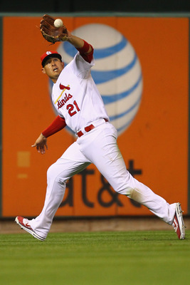 ST. LOUIS, MO - AUGUST 10: Allen Craig #21 of the St. Louis Cardinals hauls in a fly ball against the Milwaukee Brewers at Busch Stadium on August 10, 2011 in St. Louis, Missouri.  The Brewers beat the Cardinals 5-1.  (Photo by Dilip Vishwanat/Getty Image