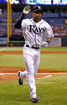 ST. PETERSBURG, FL - AUGUST 02:  Outfielder Desmond Jennings #8 of the Tampa Bay Rays rounds the bases after his home run against the Toronto Blue Jays during the game at Tropicana Field on August 2, 2011 in St. Petersburg, Florida.  (Photo by J. Meric/Ge