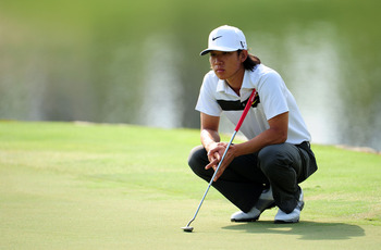 JOHNS CREEK, GA - AUGUST 12:  Anthony Kim waits on the 17th green during the second round of the 93rd PGA Championship at the Atlanta Athletic Club on August 12, 2011 in Johns Creek, Georgia.  (Photo by Stuart Franklin/Getty Images)