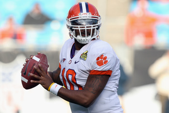 CHARLOTTE, NC - DECEMBER 31:  Tajh Boyd #10 of the Clemson Tigers drops back to pass against the USF Bulls during their game at Bank of America Stadium on December 31, 2010 in Charlotte, North Carolina.  (Photo by Streeter Lecka/Getty Images)
