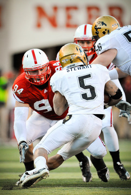 LINCOLN, NE - NOVEMBER 26: Jared Crick #94 of the Nebraska Cornhuskers zero in on for Rodney Stewart #5 of the Colorado Buffaloes during their game at Memorial Stadium on November 26, 2010 in Lincoln, Nebraska. Nebraska defeated Colorado 45-17 (Photo by E
