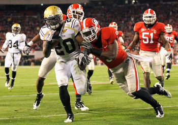 ATHENS, GA - NOVEMBER 27:  Roddy Jones #20 of the Georgia Tech Yellow Jackets rushes in for a touchdown against Alec Ogletree #9 of the Georgia Bulldogs at Sanford Stadium on November 27, 2010 in Athens, Georgia.  (Photo by Kevin C. Cox/Getty Images)