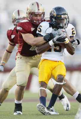 CHESTNUT HILL, MA - SEPTEMBER 11:  Anthony Bowman Jr #25 of the Kent State Golden Flashes is tackled by Ryan Quigley #46 of the Boston College Eagles on September 11, 2010 at Alumni Stadium in Chestnut Hill, Massachusetts. Boston College defeated Kent Sta