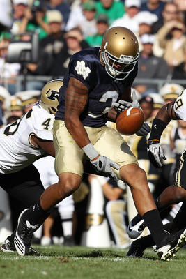 SOUTH BEND, IN - SEPTEMBER 04: Michael Flyod #3 of the Notre Dame Fighting Irish fumbles the ball near the end zone against the Purdue Boilermakers at Notre Dame Stadium on September 4, 2010 in South Bend, Indiana. (Photo by Jonathan Daniel/Getty Images)