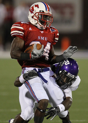 DALLAS - SEPTEMBER 24:   Wide receiver Aldrick Robinson #24 of the SMU Mustangs is tackled by Greg McCoy #7 of the TCU Horned Frogs at Gerald J. Ford Stadium on September 24, 2010 in Dallas, Texas.  (Photo by Ronald Martinez/Getty Images)