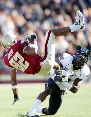 CHESTNUT HILL, MA - SEPTEMBER 26:  Cyhl Quarles #5 of the Wake Forest Demon Deacons  tackles Justin Jarvis #82 of the Boston College Eagles on September 26, 2009 at Alumni Stadium in Chestnut Hill, Massachusetts. Boston College defeated Wake Forest 27-24