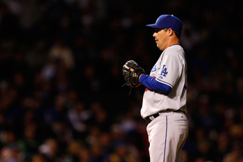 CHICAGO - OCTOBER 01:  Greg Maddux #36 of the Los Angeles Dodgers gets set to throw a pitch against the Chicago Cubs in Game One of the NLDS during the 2008 MLB Playoffs at Wrigley Field on October 1, 2008 in Chicago, Illinois.  (Photo by Jamie Squire/Get