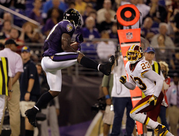 BALTIMORE, MD - AUGUST 25: Wide receiver Anquan Boldin #81 of the Baltimore Ravens catches a pass against DeAngelo Hall #23 of the Washington Redskins during the first half of a preaseason game at M&T Bank Stadium on August 25, 2011 in Baltimore, Maryland