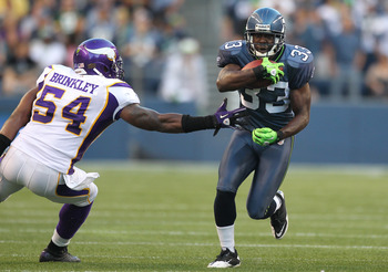SEATTLE - AUGUST 20:  Running back Leon Washington #33 of the Seattle Seahawks rushes against Jasper Brinkley #54 of the Minnesota Vikings at CenturyLink Field on August 20, 2011 in Seattle, Washington. The Vikings won 20-7. (Photo by Otto Greule Jr/Getty