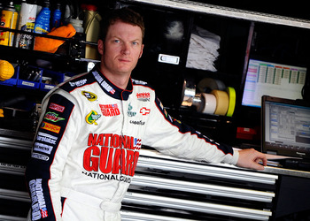 WATKINS GLEN, NY - AUGUST 12:  Dale Earnhardt Jr., driver of the #88 National Guard/Amp Energy Chevrolet, stands in the garage during practice for the NASCAR Sprint Cup Series Heluva Good! Sour Cream Dips at the Glen at Watkins Glen International on Augus