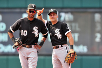 CLEVELAND, OH - JULY 24: Alexei Ramirez #10 and Omar Vizquel #11 of the Chicago White Sox goof off during a pitching change during the ninth inning against the Cleveland Indians at Progressive Field on July 24, 2011 in Cleveland, Ohio. The White Sox defea