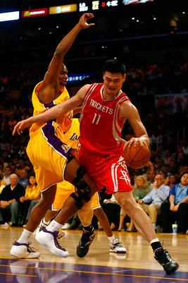 LOS ANGELES, CA - MAY 04:  Yao Ming #11 of the Houston Rockets drives on Andrew Bynum #17 of the Los Angeles Lakers in the second half of Game One of the Western Conference Semifinals during the 2009 NBA Playoffs at Staples Center on May 4, 2009 in Los An