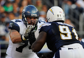 SAN DIEGO, CA - AUGUST 11:  John Moffitt #74 of the Seattle Seahawks defends against Ogemdi Nwagbuo #91 of the San Diego Chargers during the NFL preseason game at Qualcomm Stadium on August 11, 2011 in San Diego, California.  (Photo by Kevork Djansezian/G