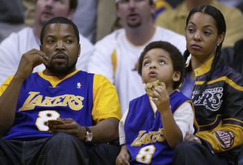 LOS ANGELES - MAY 11:  Actor-musician Ice Cube (L) and family attend Game 4 of the Western Conference semi-finals between the San Antonio Spurs and the Los Angeles Lakers on May 11, 2004 at Staples Center in Los Angeles, California. (Photo by Vince Bucci/