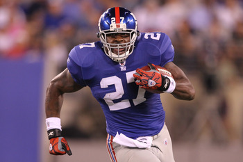 EAST RUTHERFORD, NJ - AUGUST 22: Brandon Jacobs #27 of the New York Giants runs the ball against the Chicago Bears during their pre season game on August 22, 2011 at The New Meadowlands Stadium in East Rutherford, New Jersey.  (Photo by Al Bello/Getty Ima