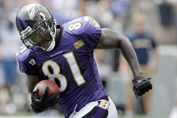 BALTIMORE, MD - AUGUST 06:  Anquan Boldin #81 of the Baltimore Ravens carries the ball during training camp at M&amp;T Bank Stadium on August 6, 2011 in Baltimore, Maryland.  (Photo by Rob Carr/Getty Images)