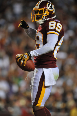 LANDOVER, MD - AUGUST 12:  Santana Moss #89 of the Washington Redskins celebrates his touchdown against the Pittsburgh Steelers at FedExField on August 12, 2011 in Landover, Maryland. The Redskins are tied with the Steelers 7-7 at the half. (Photo by Larr