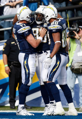 SAN DIEGO - JANUARY 03:  (L-R) Philip Rivers #17, Antonio Gates #85 and Malcom Floyd #80 of the San Diego Chargers celebrate a touchdown by Gates in the first half against the Washington Redskins at Qualcomm Stadium on January 3, 2010 in San Diego, Califo