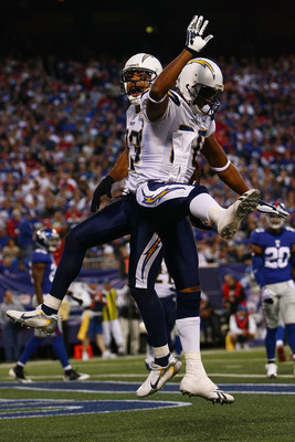 EAST RUTHERFORD, NJ - NOVEMBER 08:  Vincent Jackson #83 of the San Diego Chargers celebrates his touchdown with teammate Malcolm Floyd #80 against  the New York Giants on November 8, 2009 at Giants Stadium in East Rutherford, New Jersey.  (Photo by Chris