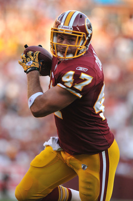 LANDOVER - SEPTEMBER 19:  Chris Cooley #47 of the Washington Redskins runs the ball in for a touchdown against the Houston Texans at FedExField on September 19, 2010 in Landover, Maryland. The Texans defeated the Redskins 30-27 in overtime. (Photo by Larr