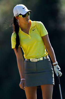 NORTH PLAINS, OR - AUGUST 19:  Michelle Wie watches her putt on the 16th hole during the first round of Safeway Classic at Pumpkin Ridge Golf Club on August 19, 2011 in North Plains, Oregon.  (Photo by Jonathan Ferrey/Getty Images)