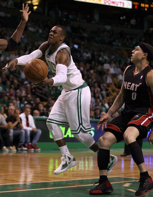 BOSTON, MA - MAY 09: Rajon Rondo #9 of the Boston Celtics is tripped by Mike Bibby #0 of the Miami Heat in Game Four of the Eastern Conference Semifinals in the 2011 NBA Playoffs on May 9, 2011 at the TD Garden in Boston, Massachusetts.  NOTE TO USER: Use