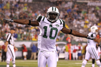 EAST RUTHERFORD, NJ - AUGUST 21:  Santonio Holmes #10 of the New York Jets celebrates after scoring a touchdown against Chris Crocker #42 of the Cincinnati Bengals in the first quarter during their pre season game on August 21, 2011 at the New Meadowlands