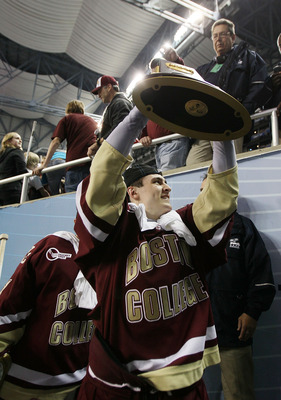 DETROIT - APRIL 10:  Chris Kreider #19 of the Boston College Eagles carries the trophy off the ice after the championship game of the 2010 NCAA Frozen Four on April 10, 2010 at Ford Field in Detroit, Michigan. Boston College defeated Wisconsin 5-0 to win