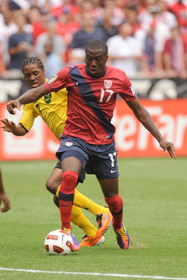 WASHINGTON, DC - JUNE 19:   Jozy Alitidore #17 of the United States tries to get a shot off against Maurice Adu #7 of Jamaica during the 2011 Gold Cup Quarterfinals on June 19, 2011 at RFK Stadium in Washington, DC  (Photo by Mitchell Layton/Getty Images)