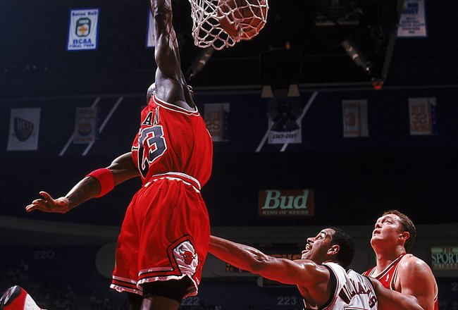 23 Jan 1998:  Michael Jordan #23 of the Chicago Bulls dunks the ball during the game against the New Jersey Nets at the Continental Arena in East Rutherford, New Jersey. The Bulls defeated the Nets 100-98 in overtime.   Mandatory Credit: Jamie Squire  /Al