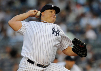 NEW YORK, NY - AUGUST 23:  Bartolo Colon #40 of the New York Yankees pitches against the Oakland Athletics during a game at Yankee Stadium on August 23, 2011 in the Bronx borough of New York City.  (Photo by Patrick McDermott/Getty Images)
