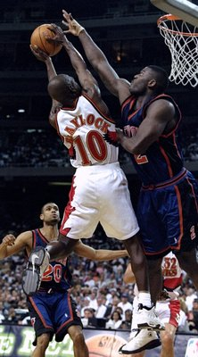 7 Apr 1998:  Mookie Blaylock #10 of the Atlanta Hawks has his shot blocked by Larry Johnson #2 of the New York Knicks during a game at the Georgia Dome in Atlanta, Georgia. The Hawks defeated the Knicks 92-79. Mandatory Credit: Jamie Squire  /Allsport