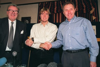 17 NOV 1995: TOMAS BROLIN SIGNS FOR LEEDS UNITED FOOTBALL CLUB FOR A RECORD FOUR AND A  HALF MILLION POUNDS SEEN HERE WITH BILL FOTHERBY MANAGING DIRECTOR AND HOWARD WILKINSON LEEDS TEAM MANAGER Mandatory Credit: Allsport UK/ALLSPORT