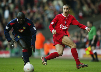 LIVERPOOL, ENGLAND - FEBRUARY 15: Bruno Cheyrou of Liverpool battles with Amdy Faye of Portsmouth during the FA Cup Fifth Round match between Liverpool and Portsmouth at Anfield on February 15, 2004 in Liverpool, England.  (Photo by Clive Brunskill/Getty