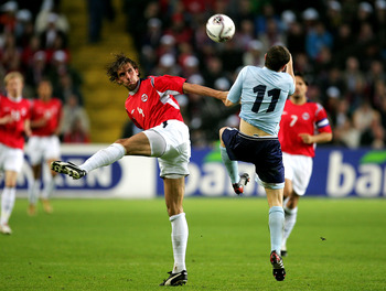 OSLO, NORWAY - SEPTEMBER 07:  James McFadden of Scotland is tackled by Claus Lundekvam of Norway during the group 5 World Cup 2006 Qualifier between Norway and Scotland held at the Ullevaal Stadium on September 7, 2005 Oslo, Norway.  (Photo by Richard Hea