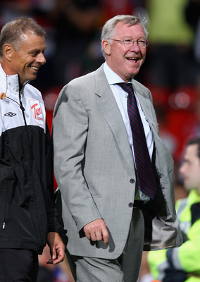 MANCHESTER, ENGLAND - AUGUST 22:  Manchester United manager Sir Alex Ferguson smiles after victory in the Barclays Premier League match between Manchester United and Tottenham Hotspur at Old Trafford on August 22, 2011 in Manchester, England.  (Photo by A