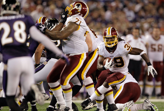BALTIMORE, MD - AUGUST 25: Tim Hightower #39 of the Washington Redskins carries the ball for a touchdown against the Baltimore Ravens during the first half of a preseason game at M&T Bank Stadium on August 25, 2011 in Baltimore, Maryland.  (Photo by Rob C