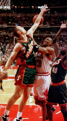 16 Jun 1996: Chicago Bull Scottie Pippen of the Chicago Bulls attempts to put up a shot between Detlef Schrempf (L) and Shawn Kemp of the Seattle SuperSonics during first quarter action in game six of the 1996 NBA finals at the United Center in Chicago, I