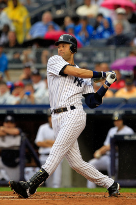 NEW YORK, NY - AUGUST 25: Derek Jeter #2 of the New York Yankees triples on a sharp line drive in the first inning against the Oakland Athletics on August 25, 2011 at Yankee Stadium in the Bronx borough of New York City.  (Photo by Chris Trotman/Getty Ima