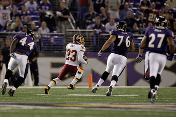 BALTIMORE, MD - AUGUST 25: DeAngelo Hall #23 of the Washington Redskins returns an interception for a touchdown against the Baltimore Ravens during the first half of a preaseason game at M&T Bank Stadium on August 25, 2011 in Baltimore, Maryland.  (Photo