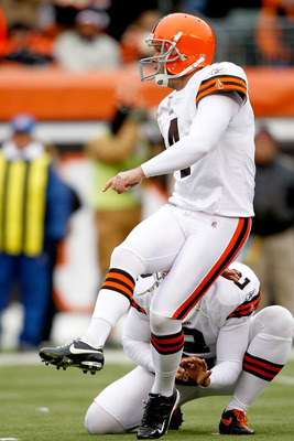 CINCINNATI, OH - DECEMBER 19:  Phil Dawson #4 of the Cleveland Browns kicks field goal against the Cincinnati Bengals at Paul Brown Stadium on December 19, 2010 in Cincinnati, Ohio.  (Photo by Matthew Stockman/Getty Images)