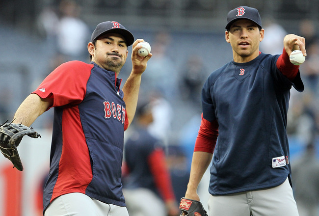 NEW YORK, NY - MAY 14:  Adrian Gonzalez #28 (L) and Jacoby Ellsbury #2 of the Boston Red Sox warm up before playing the New York Yankees on May 14, 2011 at Yankee Stadium in the Bronx borough of New York City.  (Photo by Jim McIsaac/Getty Images)