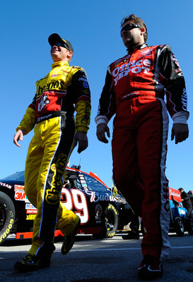 DAYTONA BEACH, FL - FEBRUARY 12:  Clint Bowyer, driver of the #33 Cheerios Chevrolet,  and Tony Stewart, driver of the #14 Mobil 1/Office Depot Chevrolet, walk on pit road during practice for the NASCAR Sprint Cup Series Daytona 500 at Daytona Internation