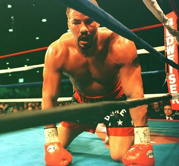 7 OCT 1995:  TOMMY MORRISON KNEELS ON THE CANVAS AFTER BEING KNOCKED DOWN AND STOPPED BY LENNOX LEWIS IN THE 6TH ROUND OF THEIR HEAVYWEIGHT BOUT AT THE ATLANTIC CITY CONVENTION CENTER IN ATLANTIC CITY, NEW JERSEY. Mandatory Credit: Simon Bruty/ALLSPORT