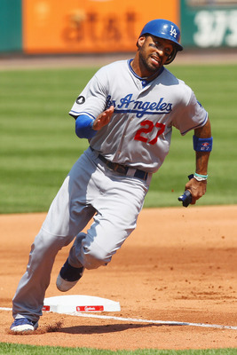 ST. LOUIS, MO - AUGUST 24: Matt Kemp #27 of the Los Angeles Dodgers rounds third base on his way to scoring a run against St. Louis Cardinals at Busch Stadium on August 24, 2011 in St. Louis, Missouri.  (Photo by Dilip Vishwanat/Getty Images)