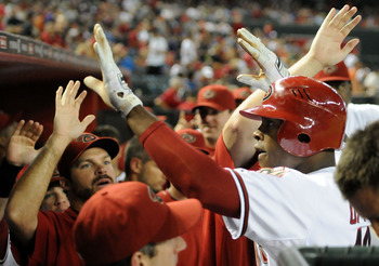 PHOENIX, AZ - AUGUST 12:  Justin Upton #10 of the Arizona Diamondbacks and his teammates celebrate his first inning home run against the New York Mets at Chase Field on August 12, 2011 in Phoenix, Arizona.  (Photo by Norm Hall/Getty Images)