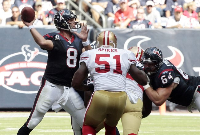 HOUSTON - OCTOBER 25:  Quarterback Matt Schaub #8 of the Houston Texans throws in the pocket as he is pressured by linebacker Takeo Spikes #51 of the San Francisco 49ers at Reliant Stadium on October 25, 2009 in Houston, Texas.  (Photo by Bob Levey/Getty