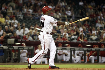 PHOENIX, AZ - AUGUST 30:  Justin Upton #10 of the Arizona Diamondbacks hits a two run home against the Colorado Rockies during the eighth inning of the Major League Baseball game at Chase Field on August 30, 2011 in Phoenix, Arizona.  The Diamondbacks def