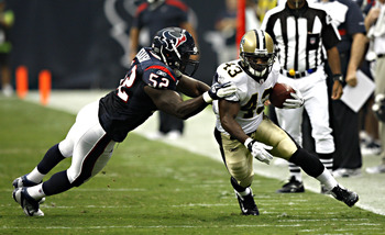 HOUSTON - AUGUST 20:  Running back Darren Sproles #43 of the New Orleans Saints is forced out of bounds by linebacker Xavier Adibi #52 of the Houston Texans at Reliant Stadium on August 20, 2011 in Houston, Texas.  (Photo by Bob Levey/Getty Images)